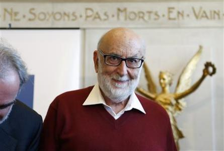 Belgian physicist Francois Englert arrives at a news conference at the University of Brussels